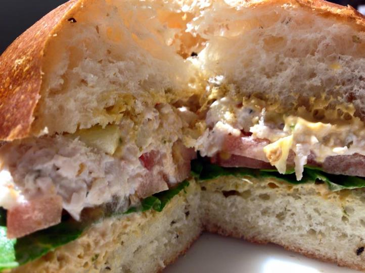 Chicken salad with lettuce and tomato on bread