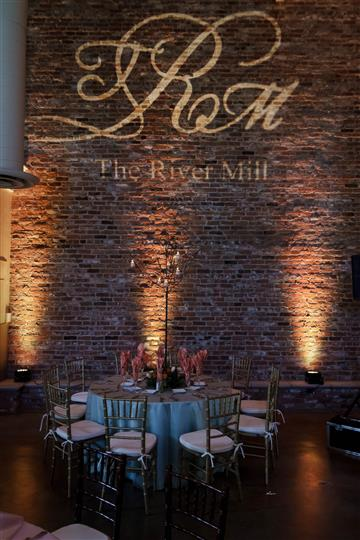 The River Mill logo above table and chairs