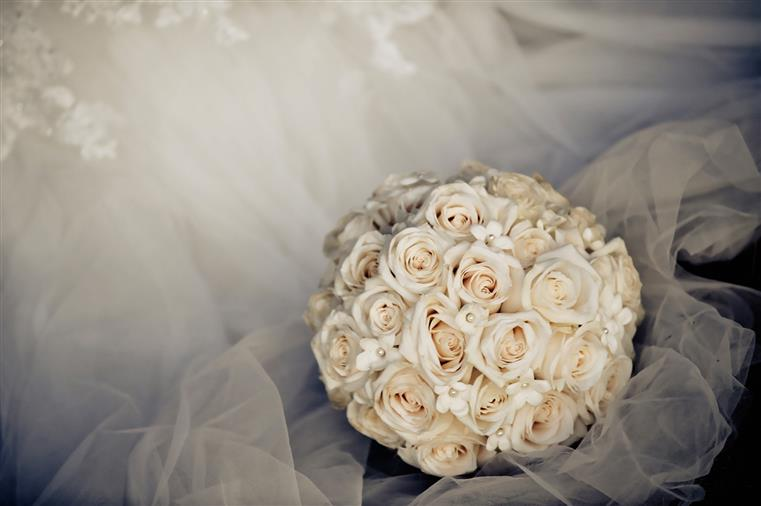 White flower bouquet with white lace in the background
