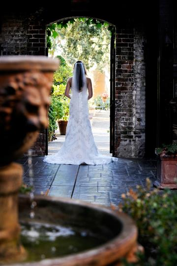Bride in background of fountain shot
