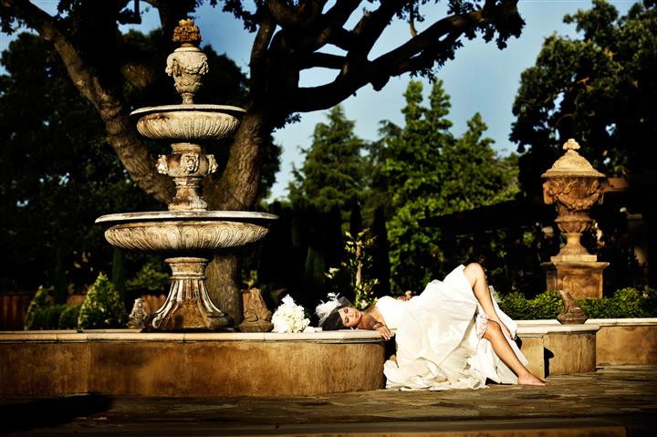 Bride laying on fountain