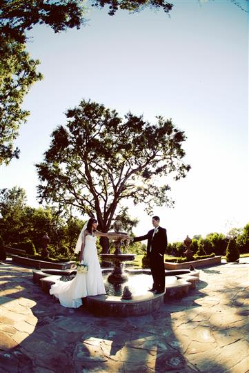 Bride and groom standing on fountain