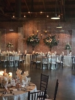 Winery Head table with garland and floral behind