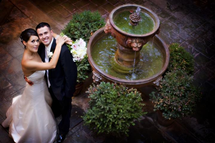 Bride and groom next to fountain