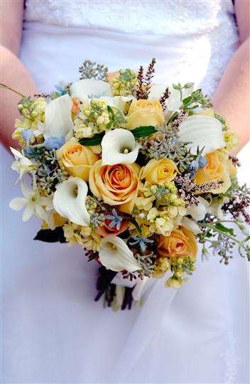 Bride holding canary flower bouquet