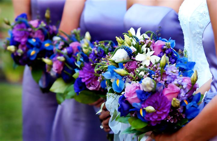 Wedding party holding flowers