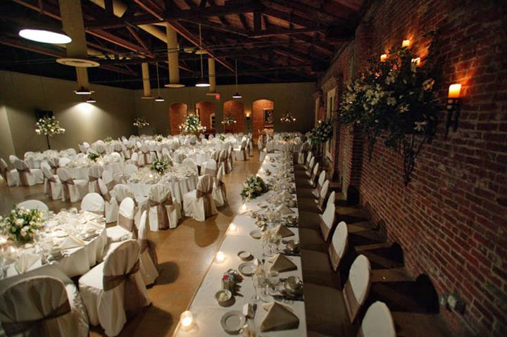 Long white table with candles