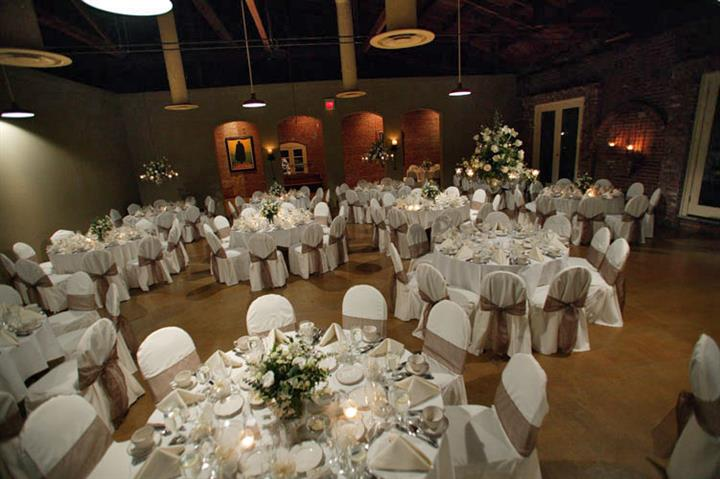 White cloth tables, chairs and flowers
