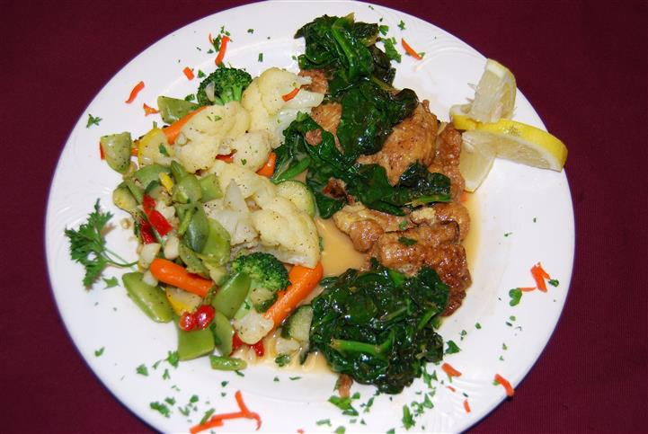 Chicken served with mixed vegetables