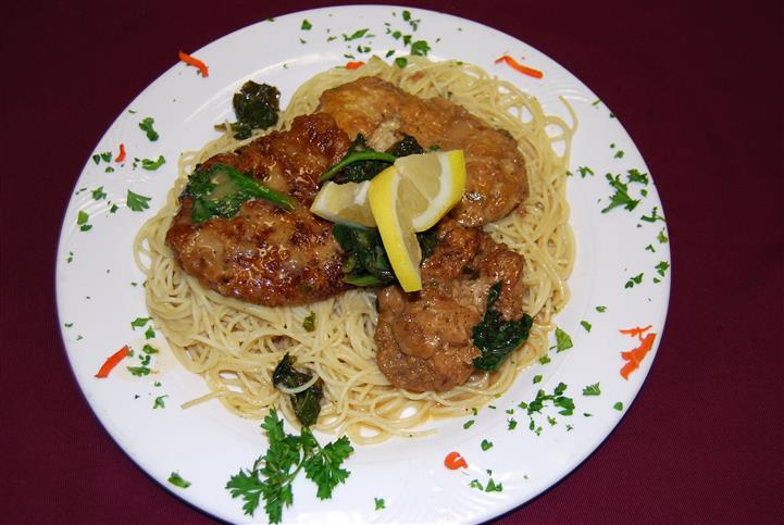 Spaghetti topped with chicken and lemon