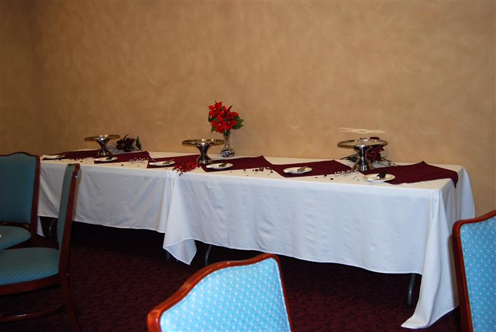 Catering table with flowers and vases