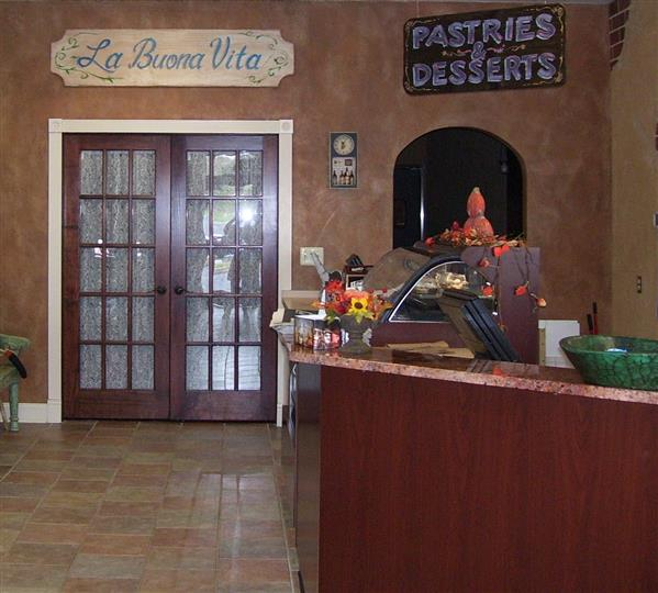 Register area next to sign that says La Buona Vita