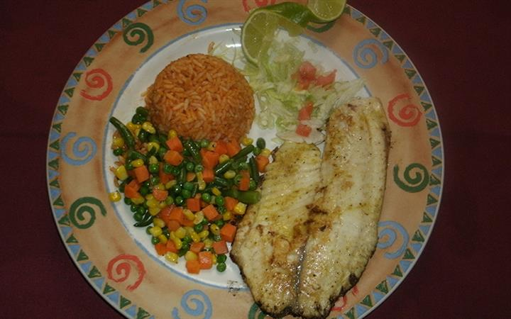 Fish with rice and mixed vegetables