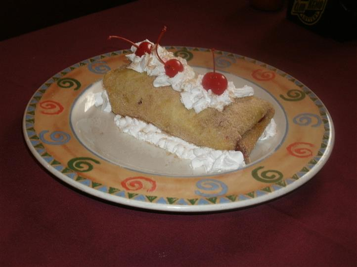 Pastry with whipped cream and cherrys