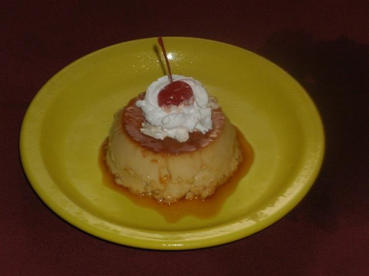 Flan with Whipped cream and a cherry on top