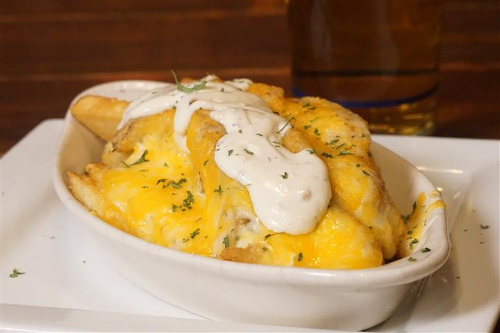 Dingle fish pie. Fresh cod, salmon,  shrimp, potatoes and peas in a Parmesan cream sauce. Encrusted with cheddar cheese