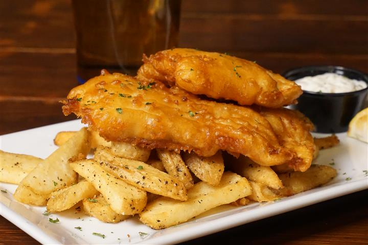 Kyle's Fish N' Chips. North Atlantic cod filets, beer battered and fried golden brown. Served with steak fries, tartar, old bay coleslaw and lemon wedge.