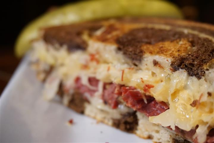 Reuben sandwich. Thumann's gourmet corned beef with sauerkraut, Swiss, and thousand island on Cinotti's thick marble rye.