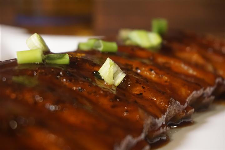 Rack of ribs closeup on white dish