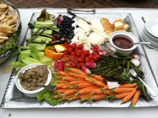 Platter with vegetables  along with spreads and syrups