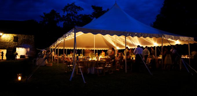 Party tent at night with people inside