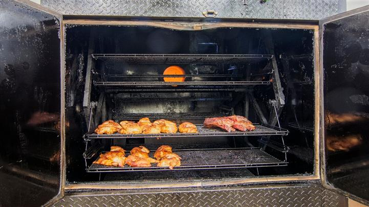 Meat grilling in a industrial sized grill