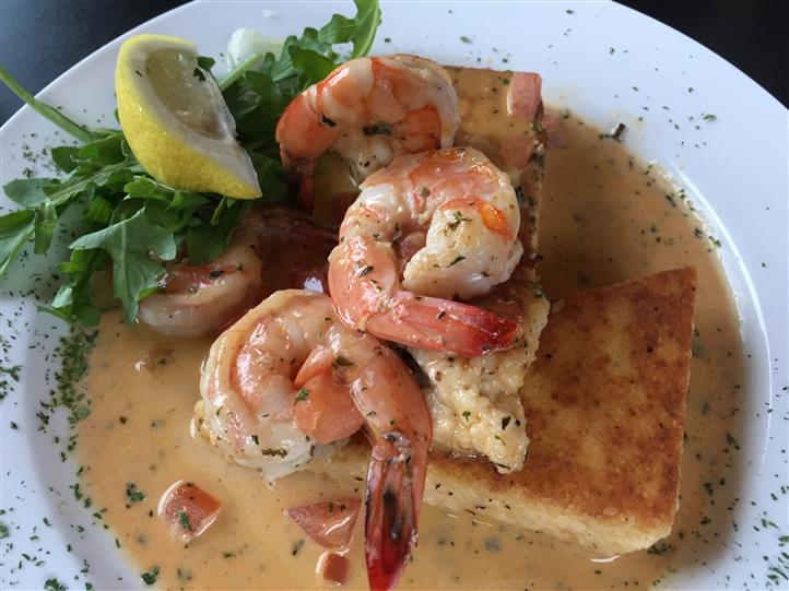Prawns sautéed in a Cajun cream sauce served with greens salad and a lemon wedge