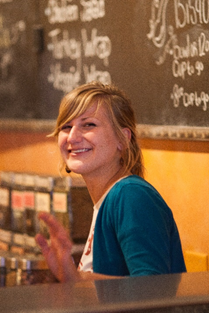 female barista smiling at the camera