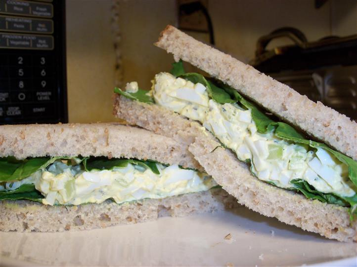 egg salad sandwich with lettuce on a plate