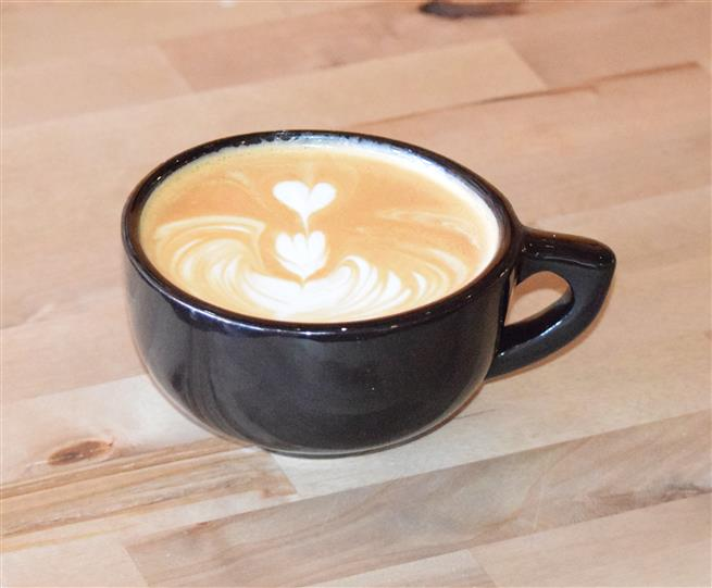 cappuccino with heart design in foam