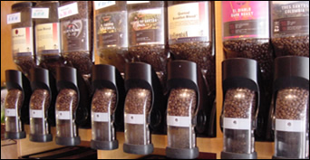 fresh coffee beans in dispensers