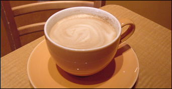 hot latte with swirling foam