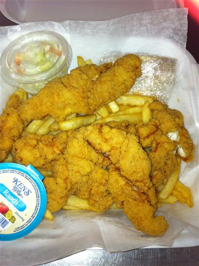 Chciken tenders with french fries and ranch dipping sauce on the side