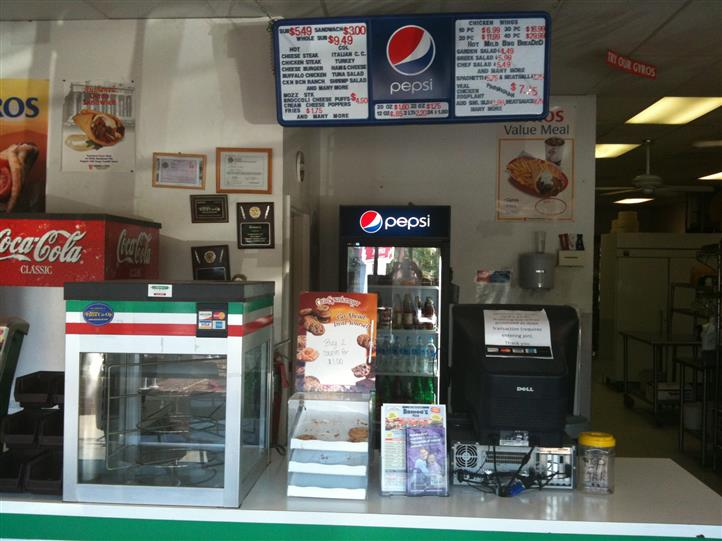 The counter at the front of Romeo's Pizza