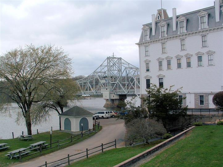 Outdoor photo of the restaurant next to a bridge by the river