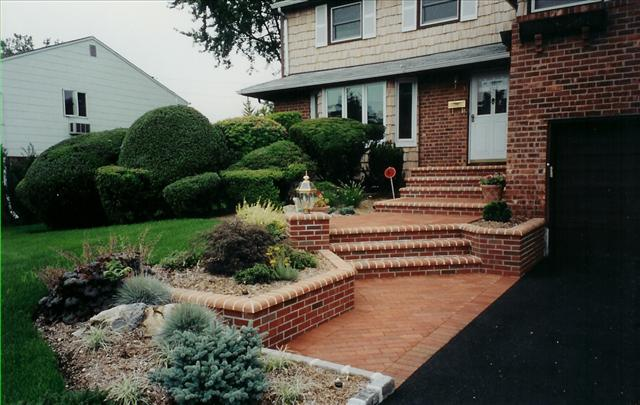 brick front walkway with seven steps to front door