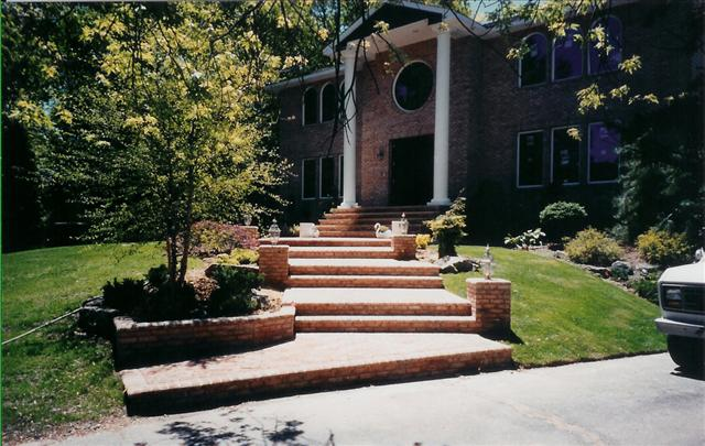 brick walkway to front door with many short steps