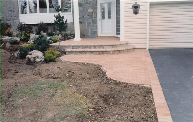 brick walkway to door with 2 steps