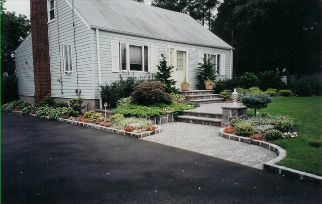stone walkway to front door of house