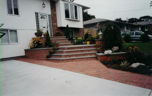 brick walkway to house with 8 steps