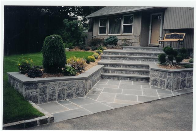 gray stone walkway to door with 6 steps
