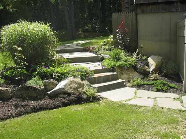 lawn with stone walkway/path with four steps