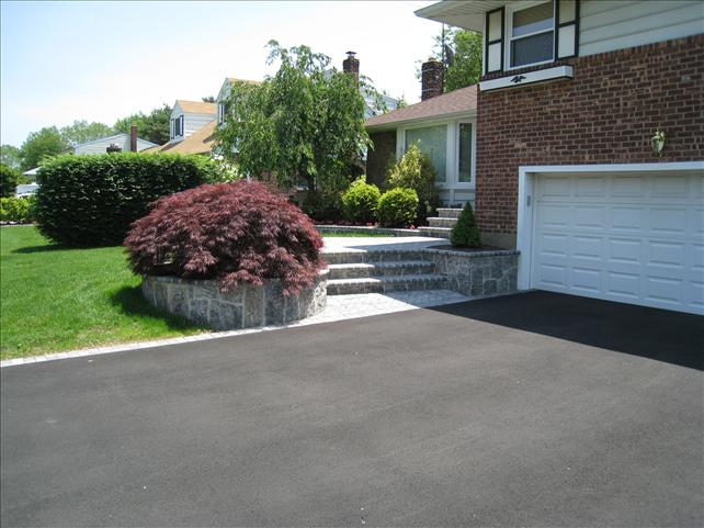 paved driveway with three stone steps