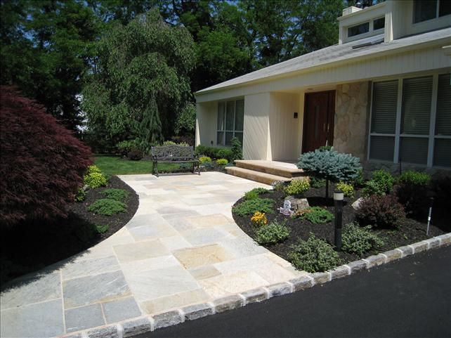 white stone walkway with two steps