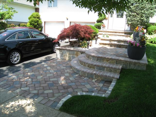 white brick/stone walkway with scattered steps to front door
