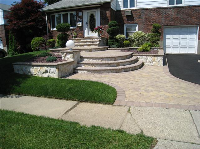 brick font entrance with stone steps to front door