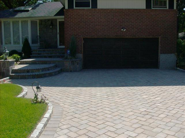 brick driveway with 6 stone steps leading to front door