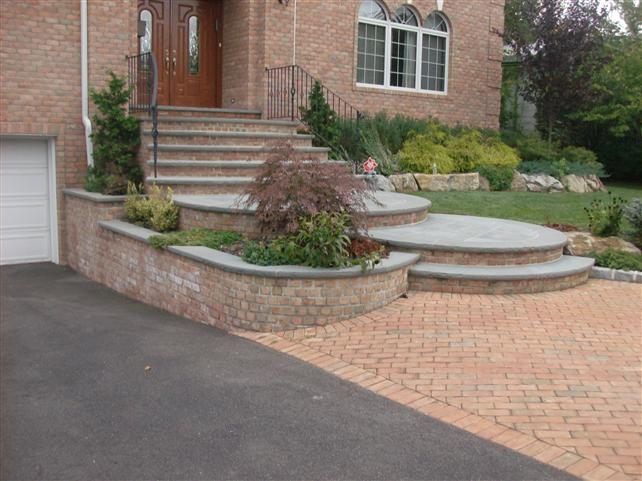 brick walkway to front door with steps