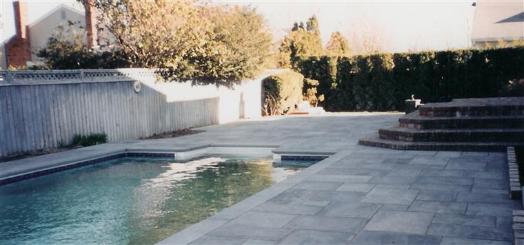 outside patio area of backyard with pool