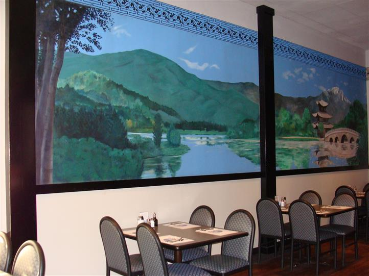 Dining area with wall painting